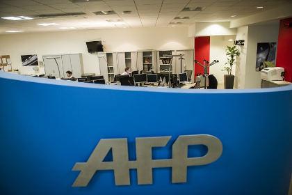 Фотограф отсудил у AFP 1,2 миллиона